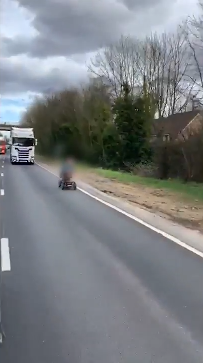 Shocking footage shows an elderly man in a mobility scooter driving along a busy motorway